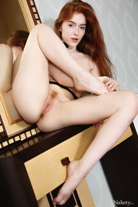 Redhead Jia Lissa Plays With Pink Pussy