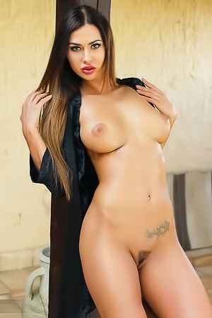 Curvaceous Brunette Justyna Slips Off Her Robe To Pose For The Camera