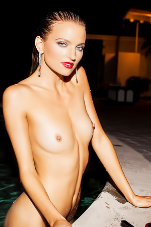 Beautiful Playmate takes a late night swim