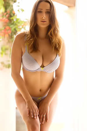 Ashley Adams Busty Ashley Adams stripteases outdoors
