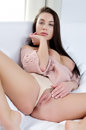 Sabrisse posing sensually on bed