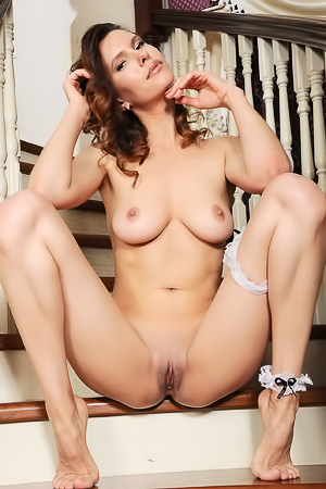 Suzanna A Parts Her Long Legs To Expose Her Shaved Pussy