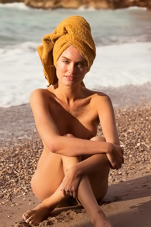 Alberte Valentine enjoying the sunny day on the beach nude